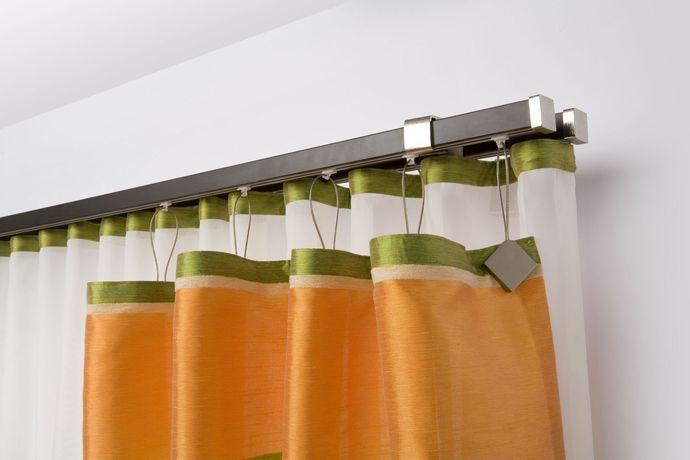 Металлическое настенное устройство для штор